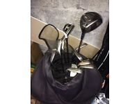 A full set of titleist irons with 910 d2 8.5 driver, Taylor made Rbz fairway wood and Dunlop putter