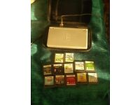 Nintendo DS Lite with selection of games, case, charger and styluses.