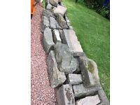 Various sized curbing stones free to who can collect them