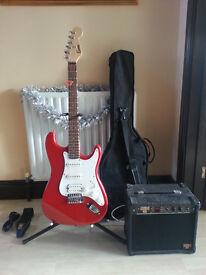 """Encore"" red electric guitar + amp, lead, case, strap, pick"