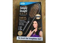 Straightening hair brush.