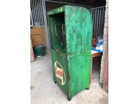 vintage oil store cabinet
