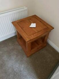 Two solid oak side tables