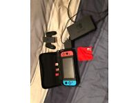 Nintendo switch with three games