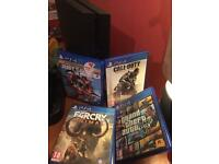 PlayStation 4 500gb with 2 remotes blue and why and 6 games