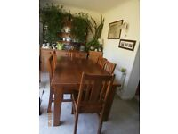 Sturdy solid wood dining table and + 6 chairs