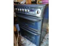 Cooker - free standing with double electric oven and ceramic hob.