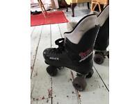 Pair of Bauer roller skates size 7