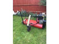 Petrol scarifier for ride on lawnmower