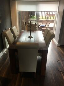 Dining table and 6 leather chairs for sale £200 Ono collection only