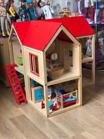 ELC dolls house with figures and Furniture in excellent condition.