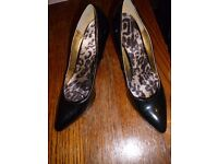 High heels black leather shoes