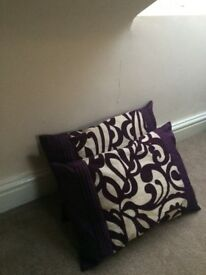 Pair of two purple and gold cushions