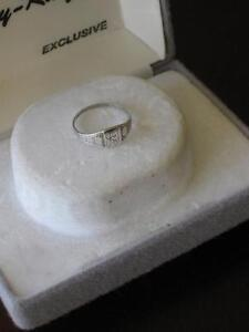 ....LADIES TINY STERLING SILVER RING..[SIZE 5 1/2]