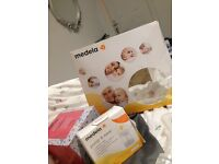 Medela swing with lots of extras