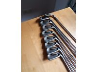 A full set of ping i3 golf clubs.