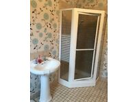 White shower cubicle. Comes with base free of charge as it is slightly chipped
