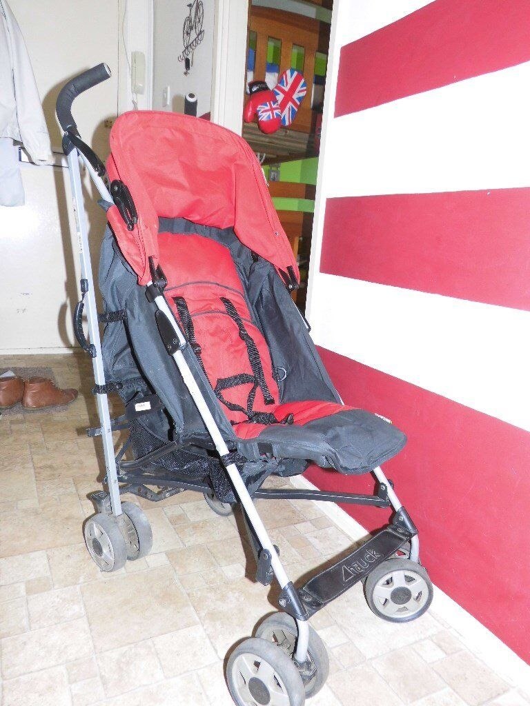 Hauck red buggy used in good condition.