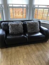 Sofa and armchair with footstool