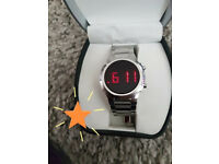 Mens Classic red display on a black face, stainless steel watch.