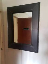 large brown leather mirror