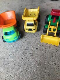 Various trucks tractors diggers