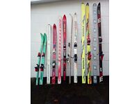 selection of adult and children skis - clear out of cupboard - all well looked after but old style
