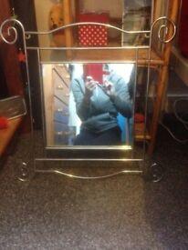 Silver mirror for sale.