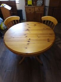 Extending Round Pine Table (pedestal) and 4 chairs,