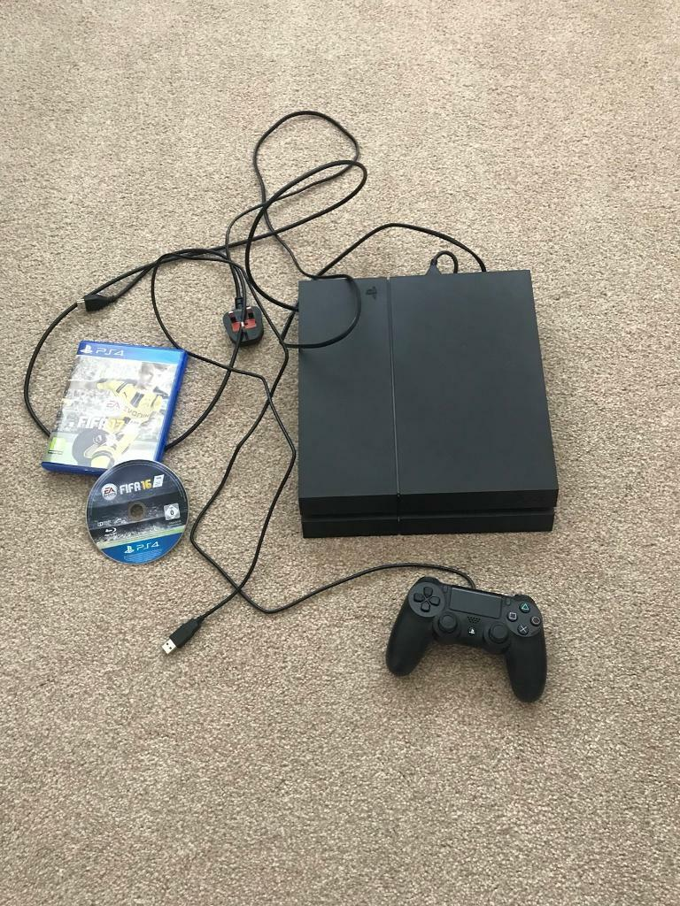 PS4 with 1 remote and 2 games (fifa 17, fifa 16) no box