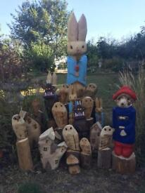 Chainsaw carvings owls rabbits fairy houses gruffalos