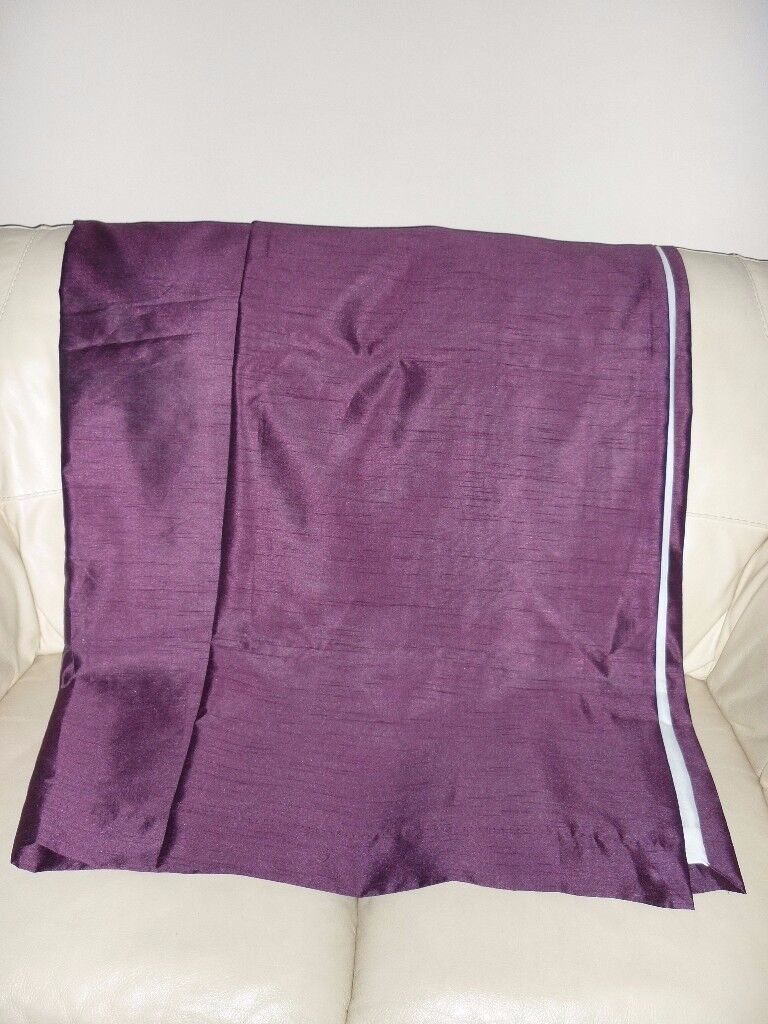 A pair of faux silk purple eyelet curtains for sale.