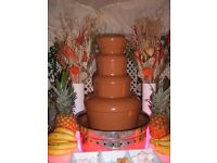 JM Posner Professional Chocolate Fountain with illuminated base and outside wind shield cabinet