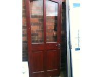Exterior hardwood door with 2 clear glass panels