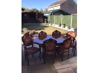 Ornate dining table with 6 chairs