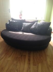 Black leather three seater cuddle sofa and chaise longue