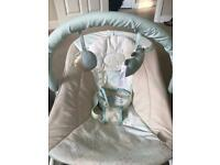 Baby rocker with removable mobile and baby activated vibration.