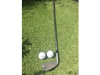 Golf club and two golf balls