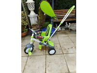 green fisher price trike with parent handle