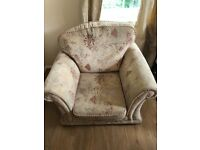 Cream single seater sofa with beautiful classical pattern and two cushions