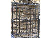 Iron gate ,tall, ornate style