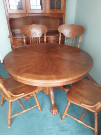 round dining table and six chairs.