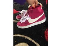 Dark pink Nike Blazes