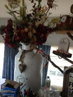 milk can with flowers 50 dollars