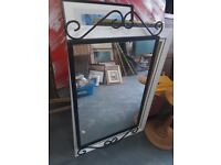 Mirror - Black decorative metal.