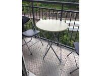 Balcony table and two chairs