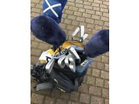Men's golf clubs and trolley