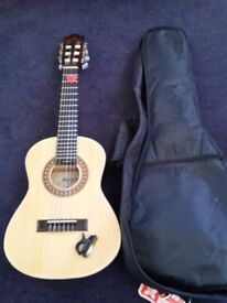 1/4 size Acoustic Guitar made by Morgan of Norway. Including carry case, tuner. Excellent condition