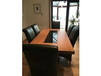 New condition Solid Oak Dinning Table 6 leather chairs and matching sideboard