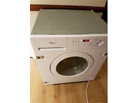 Whirlpool integrated built in Washer-Dryer. Looks and works as new. Can deliver